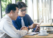 Two,Asian,Businessman,Discussing,Project,In,Office.