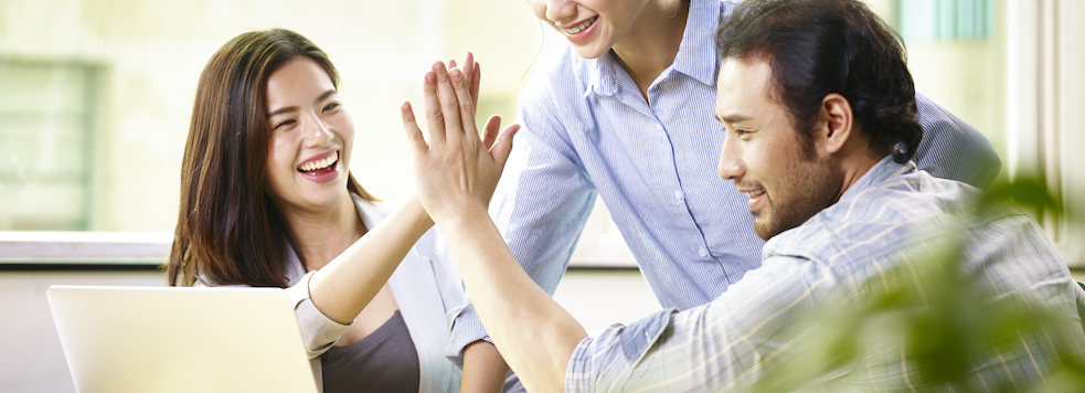 Young,Asian,Business,Person,Giving,Coworker,High,Five,In,Office